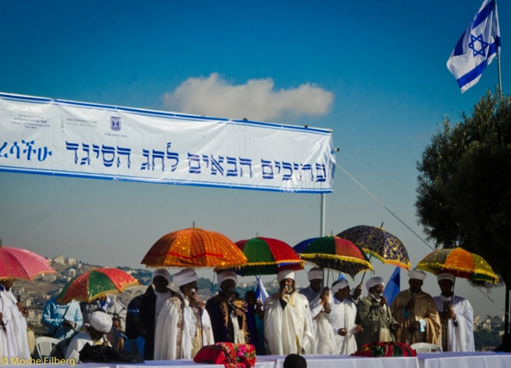 Dozens of qessotch from across Israel assembled there beneath colorful umbrellas on a platform draped with the flags of Israel and Jerusalem